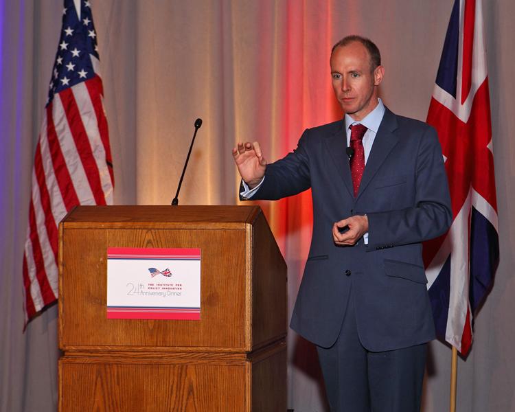 Hannan at podium